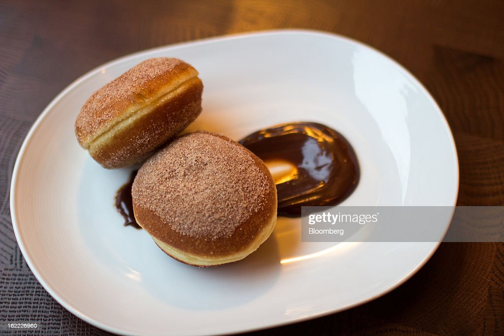 Berliner donuts, filled with Goldschlager cream, are served at The Marrow in New York, U.S., on Tuesday, Feb. 19, 2013. The Marrow is a half-German, half-Italian meatery where the sauerbraten is even better than the steak. Photographer: Philip Lewis/Bloomberg via Getty Images