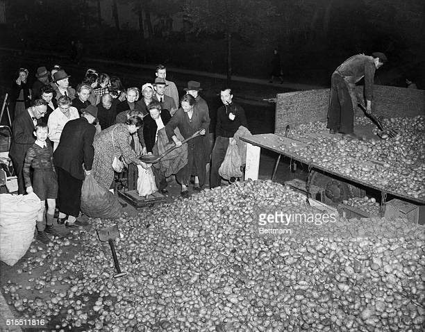Berliners queue up for part of their winter potato supply They are rationed to 400 grams slightly less than a pound a day and make them a large part...