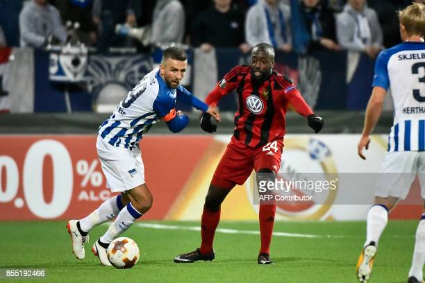 Berlin's Bosnian forward Vedad Ibisevic and Ostersund's Swedish defender Ronald Mukiibi vie for the ball during the UEFA Europa League group J...