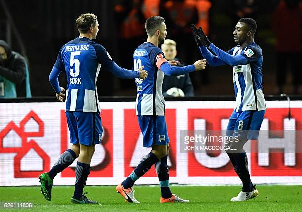 Berlin's Bosnian forward Vedad Ibisevic celebrates with Berlin's Ivorian forward Salomon Armand Kalou and Berlin's defender Niklas Stark after...