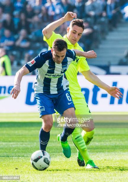 Berlin's Czech midfielder Vladimir Darida vies with Augsburg's midfielder Dominik Kohr during the Bundesliga match Hertha Berlin vs Augsburg in...