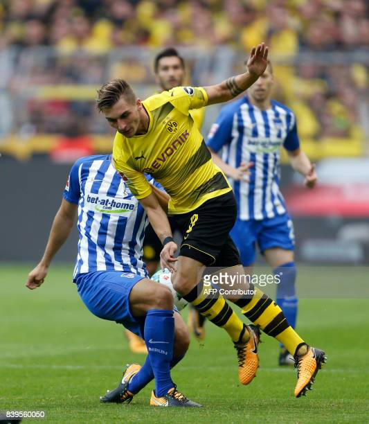 Berlin's defender Niklas Stark and Dortmund's forward Maximilian Philipp vie for the ball during the German First division Bundesliga football match...