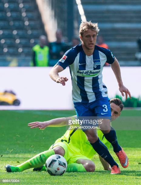 Berlin's defender Niklas Stark vies with Augsburg's midfielder Dominik Kohr during the Bundesliga match Hertha Berlin vs Augsburg in Berlin on April...
