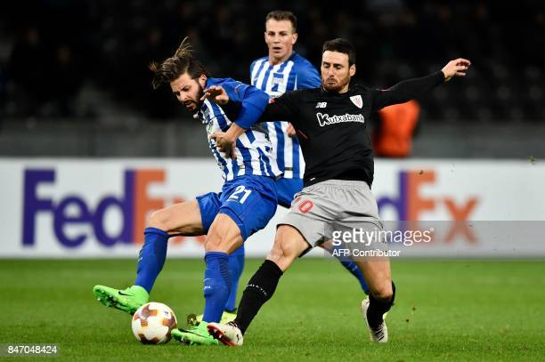 Berlin's German defender Marvin Plattenhardt and Athletic's forward Aritz Aduriz vie for the ball during the UEFA Europa League group J football...