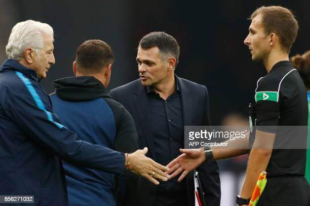 Berlin's Hungarian head coach Pal Dardai chats with Bayern Munich's French interim head coach Willy Sagnol after the German first division Bundesliga...