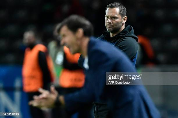 Berlin's Hungarian head coach Pal Dardai looks on as Athletic's Spanish head coach Jose Angel Ziganda shouts from the sidelines during the UEFA...