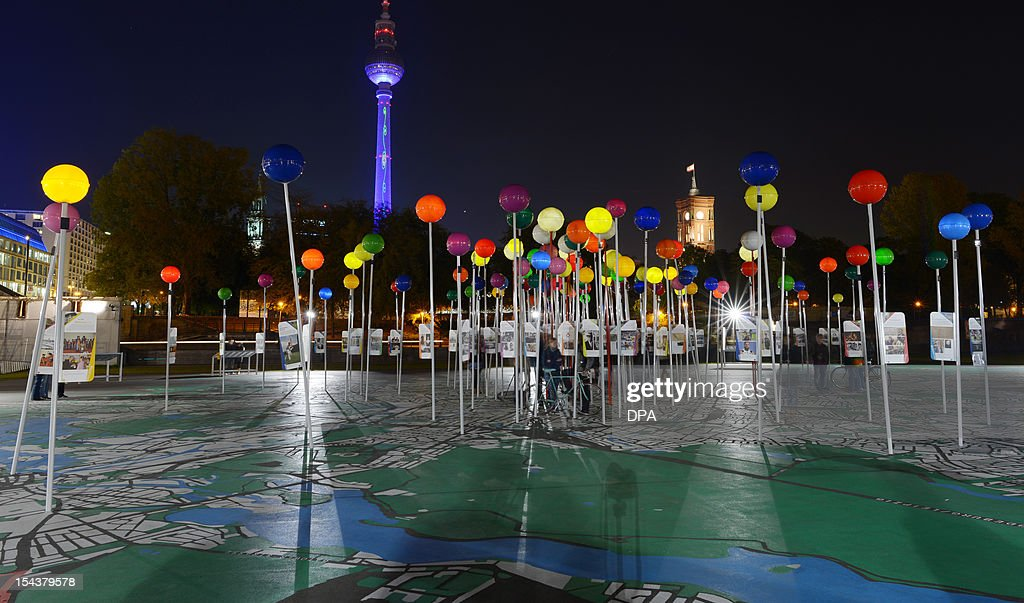 Berlin's illuminated landmark, the tv tower, is seen behind a city map installation on October 18, 2012. Dozens of landmarks and buildings in the German capital are festively illuminated during the 'Festival of Lights' running until October 20, 2012. AFP PHOTO / RAINER JENSEN GERMANY OUT