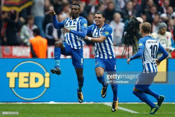 Berlin's Ivorian forward Salomon Kalou celebrates scoring the 22 goal with his teammates during the German first division Bundesliga football match...