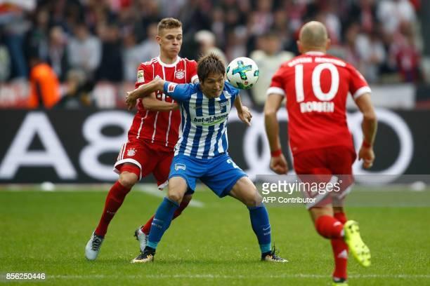 Berlin's Japanese midfielder Genki Haraguchi controls the ball during the German first division Bundesliga football match between Hertha Berlin and...