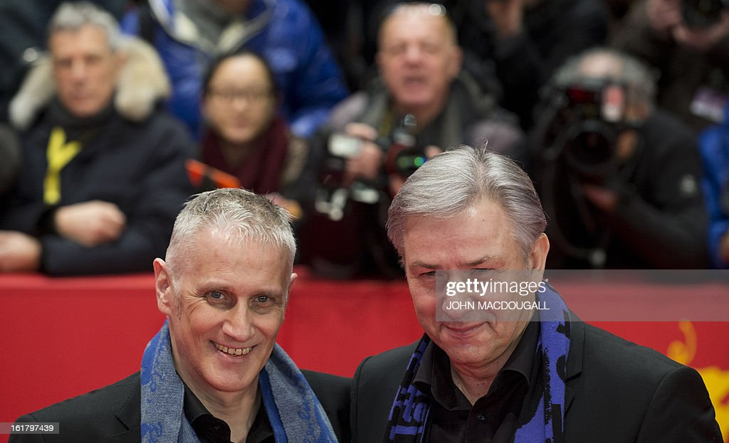 Berlin's mayor Klaus Wowereit and his partner Joern Kubicki arrive on the red carpet for the awards ceremony of the 63rd Berlinale Film Festival in Berlin on February 16, 2013.