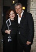 Berlin's mayor Klaus Wowereit and Nan Goldin with her award pose during the Reminders Day Aids Gala 2011 at ewerk on August 27 2011 in Berlin Germany