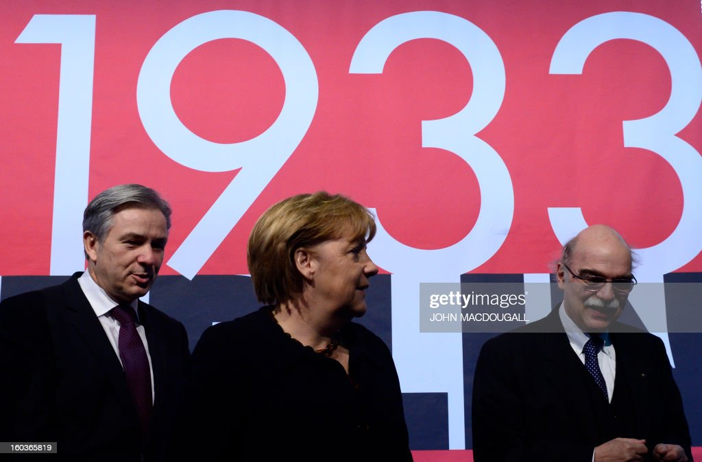 Berlin's mayor Klaus Wowereit, German Chancellor Angela Merkel, Professor Andreas Nachama, managing director of 'Topographie des Terrors' inaugurate the exhibition 'Berlin 1933 On the Path to Dictatorship', tracing Adolf Hitler's rise to power in Germany in 1933 to mark 80 years since he became chancellor on January 30, 2013 at the open-air documentation center Topographie des Terrors in Berlin. The exhibition located at the former headquarters of the Gestapo, the secret police of the Nazi regime, traces Hitler's first months in power through photos, newspapers and posters.AFP PHOTO / JOHN MACDOUGALL