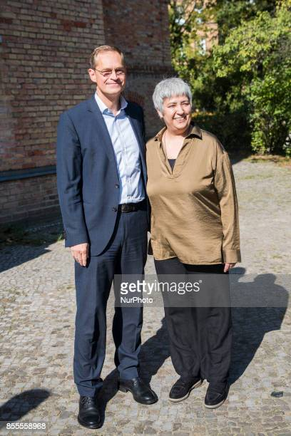 Berlin's Mayor Michael Mueller and cofounder of the Ibn RushdGoethemosque lawyer and women right activist Seyran Ates in Berlin Germany on September...