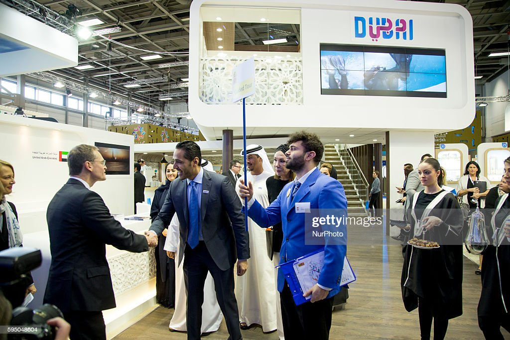 Berlin's Mayor Michael Mueller is pictured at Dubai's exhibition stand during an opening tour at the International Tourism Trade Fair in Berlin...