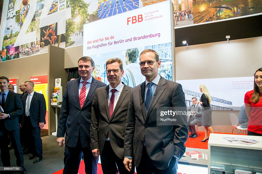 Berlin's Mayor Michael Mueller is pictured while visiting the exhibition stand of Berlin's new airport BER during an opening tour at the...