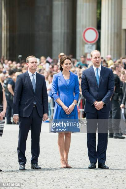 Berlin's Mayor Michael Mueller is pictured with Britain's Prince William Duke of Cambridge and his wife Kate the Duchess of Cambridge in front of...