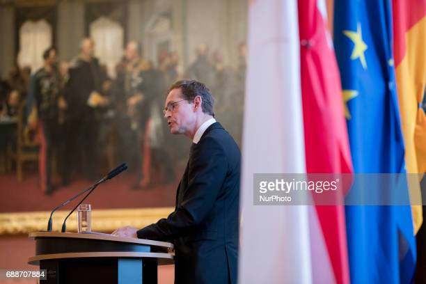 Berlin's Mayor Michael Mueller speaks during the OttoHahn Peace Medal awarding ceremony at the town hall in Berlin Germany on May 25 2017 Melinda...