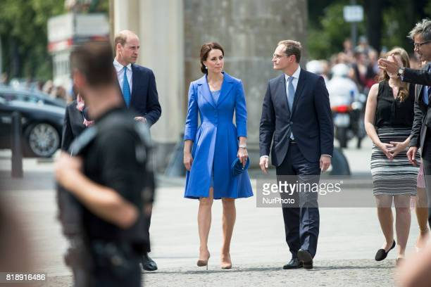 Berlin's Mayor Michael Mueller welcomes Britain's Prince William Duke of Cambridge and his wife Kate the Duchess of Cambridge in front of Brandenburg...