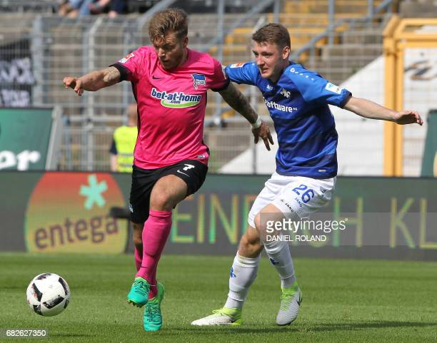 Berlin's midfielder Alexander Esswein and Darmstadt's Danish defender Patrick Banggaard vie for the ball during the German first division Bundesliga...