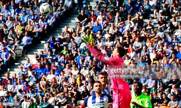 Berlin's Norwegian goalkeeper Rune Almenning Jarstein makes a save during the Bundesliga match Hertha Berlin vs Augsburg in Berlin on April 9 2017 /...