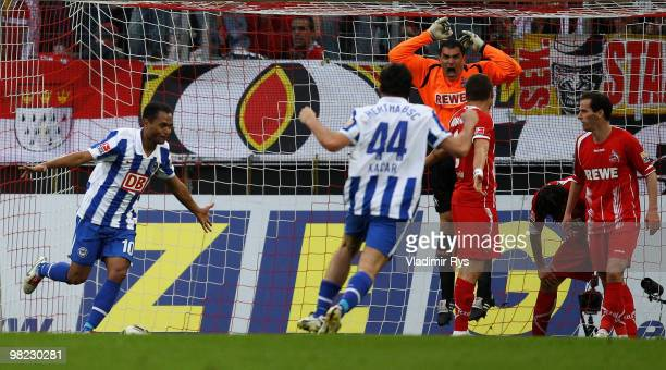 Berlin's Raffael celebrates after scoring his team's second goal as goalkeeper Faryd Mondragon of Koeln reacts during the Bundesliga match between 1...