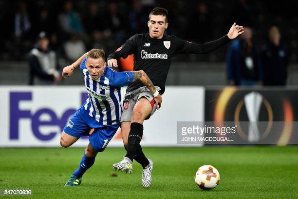 Berlin's Slovakian midfielder Ondrej Duda and Athletic's defender Asier Villalibre Molina vie for the ball during the UEFA Europa League group J...
