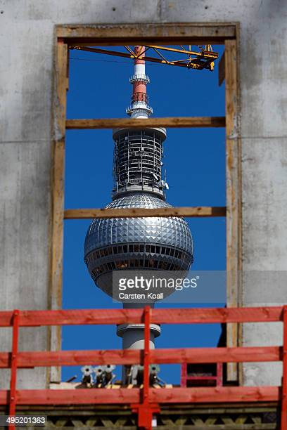 Berlin's Television Tower is seen through a window of the construction work of the Berlin City Palace in the city center on June 1 2014 in Berlin...