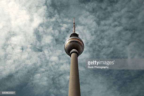 Berlin's TV Tower against a cloudy sky