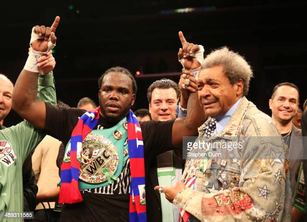 Bermane Stiverne and promoter Don King pose for photos after Stiverne defeated Chris Arreola in their WBC Heavyweight Championship match at Galen...