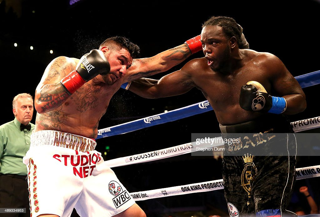 <a gi-track='captionPersonalityLinkClicked' href=/galleries/search?phrase=Bermane+Stiverne&family=editorial&specificpeople=11210776 ng-click='$event.stopPropagation()'>Bermane Stiverne</a> battles <a gi-track='captionPersonalityLinkClicked' href=/galleries/search?phrase=Chris+Arreola&family=editorial&specificpeople=3990515 ng-click='$event.stopPropagation()'>Chris Arreola</a> in their WBC Heavyweight Championship match at Galen Center on May 10, 2014 in Los Angeles, California. Stiverne won in a six round technical knockout.