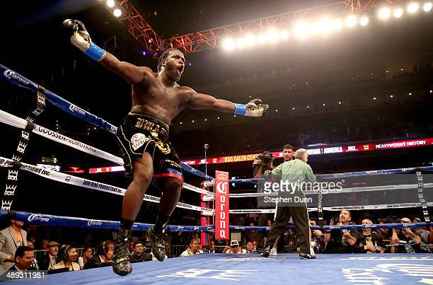 Bermane Stiverne celebrates as the referee holds Chris Arreola after stopping WBC Heavyweight Championship match at Galen Center on May 10 2014 in...