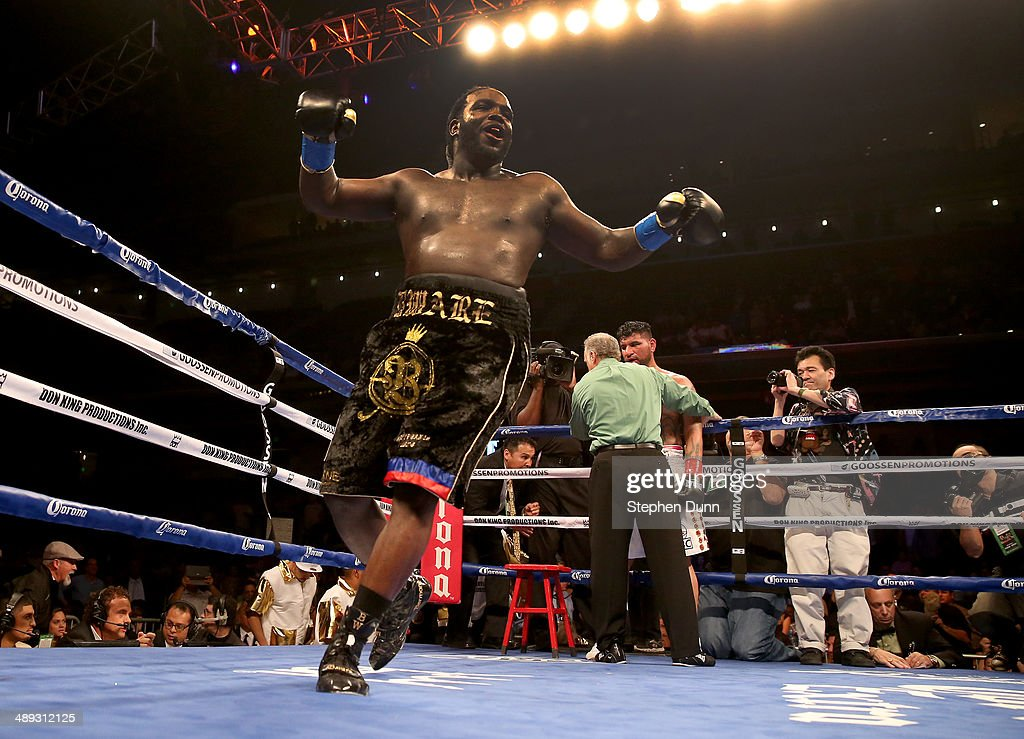 Bermane Stiverne celebrates as the referee holds Chris Arreola after stopping WBC Heavyweight Championship match at Galen Center on May 10, 2014 in Los Angeles, California. Stiverne won in a six round technical knockout.