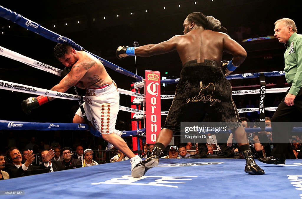 Bermane Stiverne knocks down Chris Arreola fir the second time in the sixth round of their WBC Heavyweight Championship match at Galen Center on May 10, 2014 in Los Angeles, California. Stiverne won in a six round technical knockout.