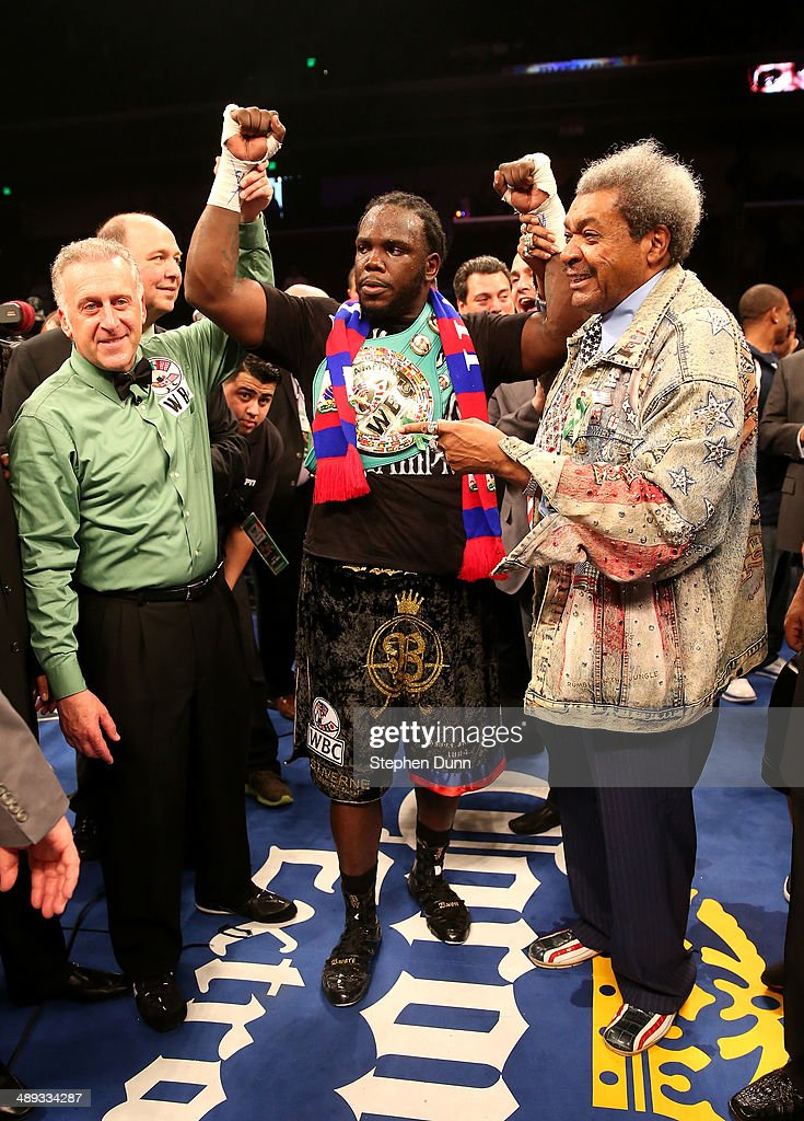 Bermane Stiverne (C) referee Jack Reiss (L) and promoter Don King pose for photos after Stiverne defeated Chris Arreola in their WBC Heavyweight Championship match at Galen Center on May 10, 2014 in Los Angeles, California. Stiverne won in a six round technical knockout.