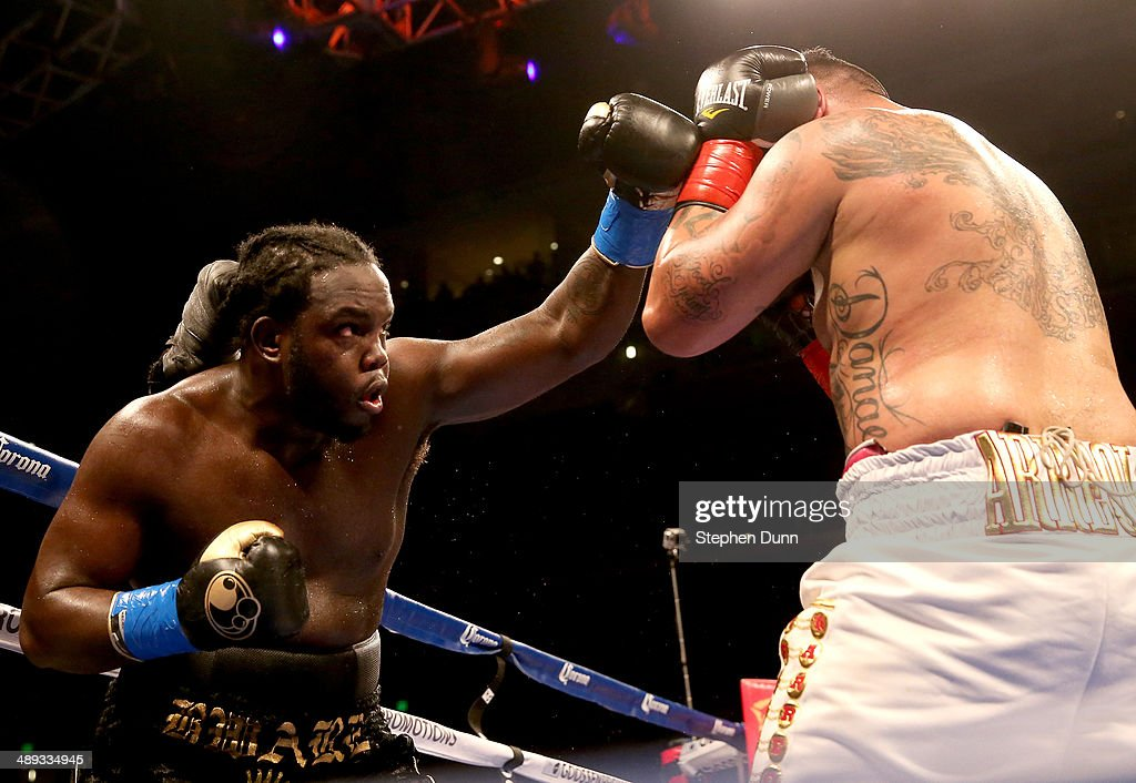 <a gi-track='captionPersonalityLinkClicked' href=/galleries/search?phrase=Bermane+Stiverne&family=editorial&specificpeople=11210776 ng-click='$event.stopPropagation()'>Bermane Stiverne</a> throws a punch at <a gi-track='captionPersonalityLinkClicked' href=/galleries/search?phrase=Chris+Arreola&family=editorial&specificpeople=3990515 ng-click='$event.stopPropagation()'>Chris Arreola</a> in their WBC Heavyweight Championship match at Galen Center on May 10, 2014 in Los Angeles, California. Stiverne won in a six round technical knockout.