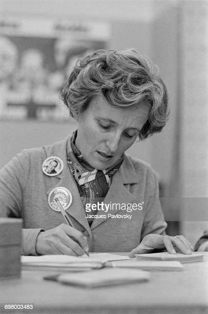 Bernadette Chirac wife of mayoral candidate for Paris Jacques Chirac answering letters from Chirac supporters in his committee room Paris 1st March...