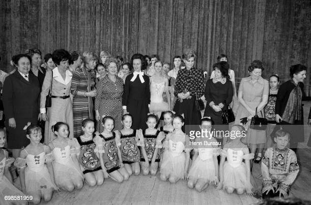 Bernadette Chirac wife of the French Prime Minister posing for an official picture with a group of young ballet dancers in Moscow Russia 20th March...