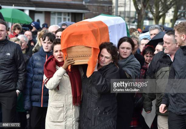 Bernadette McGuinness carries the coffin of her late husband Martin McGuinness on March 21 2017 in Londonderry Northern Ireland The 66 year old...
