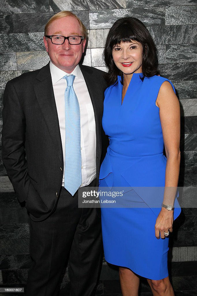 Bernadette Morra, Editor-in-Chief of Fashion Magazine (R) and Jimmy Molloy attend the Burberry supported premiere and celebration of 'Mandela: Long Walk to Freedom' hosted by The Weinstein Company and Entertainment One at the Toronto International Film Festival on September 7, 2013 in Toronto, Canada.