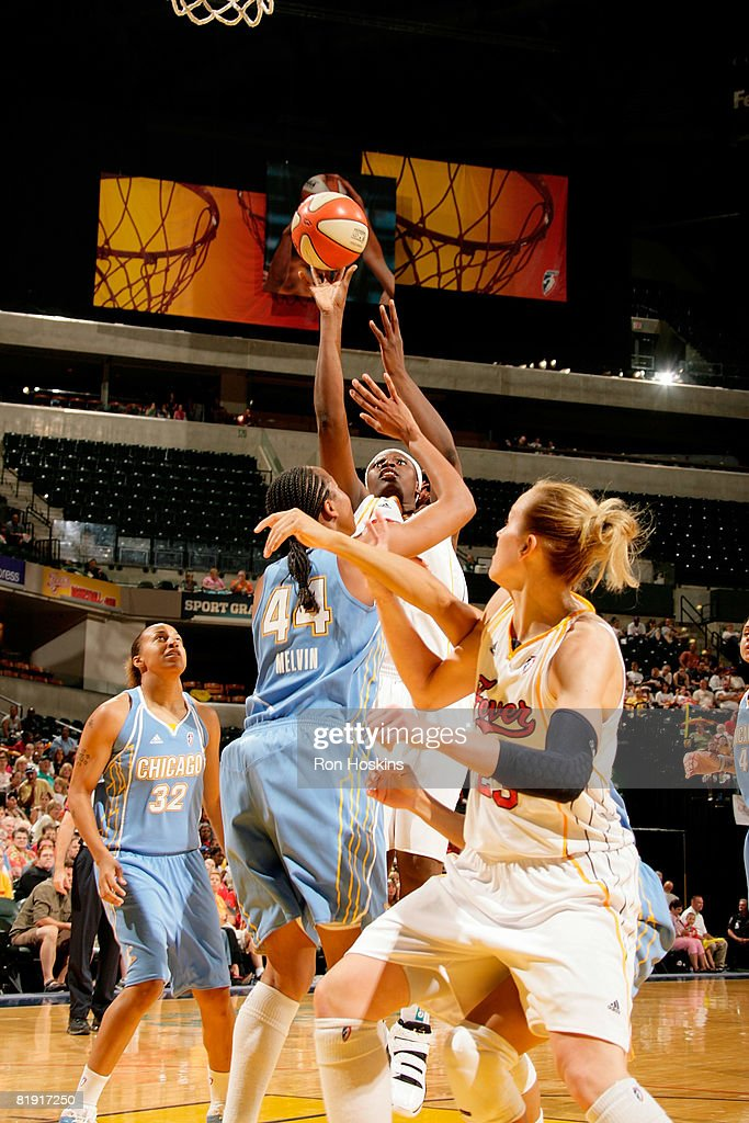 Bernadette Ngoyisa of the Indiana Fever shoots over Chasity Melvi of the Chicago Sky at Conseco Fieldhouse on July 12 2008 in Indianapolis Indiana...