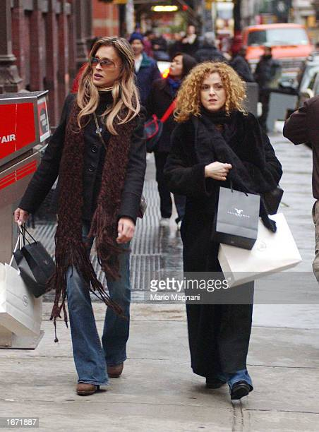 Bernadette Peters and La Perla walk on a street November 30 2002 in New York City