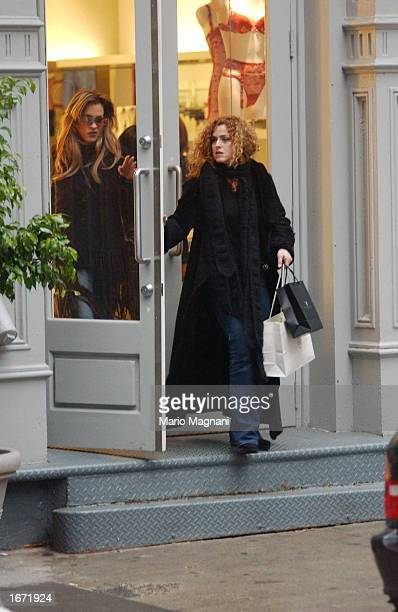 Bernadette Peters and La Perla walk out of a store November 30 2002 in New York City