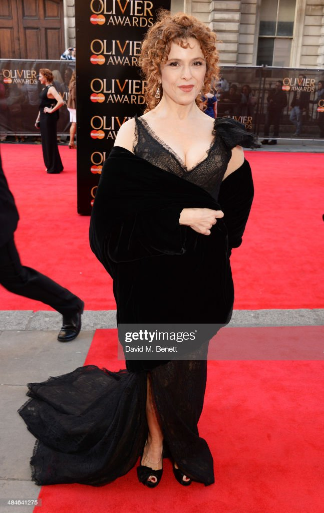 <a gi-track='captionPersonalityLinkClicked' href=/galleries/search?phrase=Bernadette+Peters&family=editorial&specificpeople=203332 ng-click='$event.stopPropagation()'>Bernadette Peters</a> attends the Laurence Olivier Awards at The Royal Opera House on April 13, 2014 in London, England.