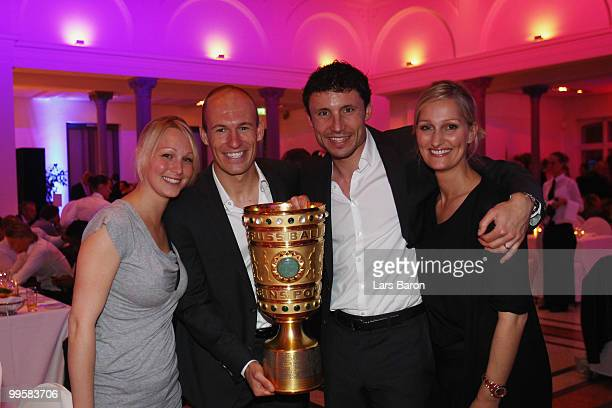 Bernadien wife of Arjen Robben Arjen Robben Mark van Bommel and his wife Andra pose with the DFB Cup trophy during the Bayern Muenchen Champions...