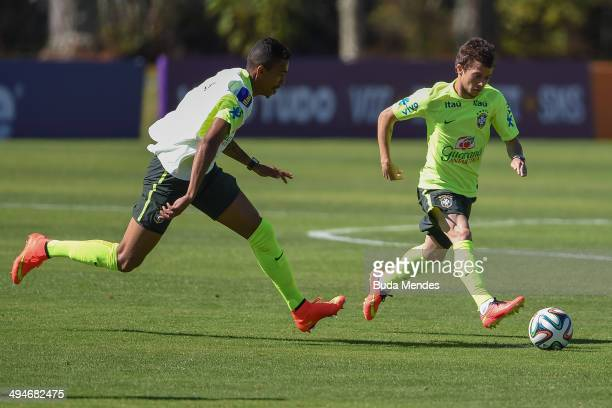 Bernard and Luis Gustavo take part in a training session of the Brazilian national football team at the squad's Granja Comary training complex in...