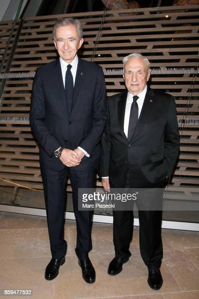 Bernard Arnault and architect Frank Gehry attend 'Etre Moderne Le MomA a Paris' exhibition at Fondation Louis Vuitton on October 9 2017 in Paris...