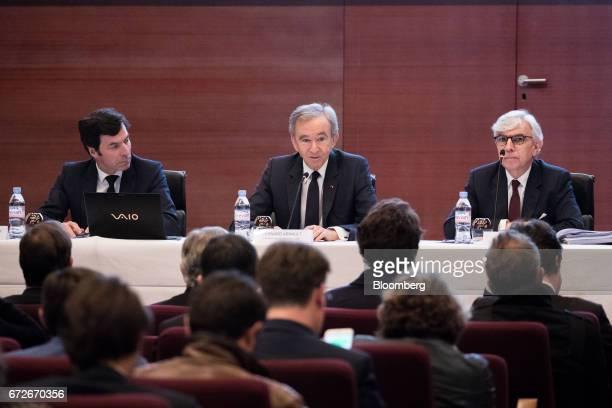 Bernard Arnault billionaire and chief executive officer of LVMH Moet Hennessy Louis Vuitton SE center speaks as Florian Ollivier chief financial...