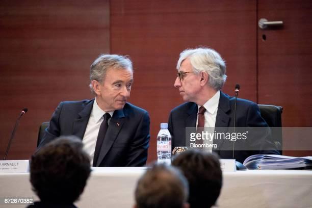 Bernard Arnault billionaire and chief executive officer of LVMH Moet Hennessy Louis Vuitton SE left sits beside Florian Ollivier chief financial...