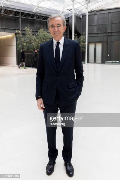 Bernard Arnault billionaire and chief executive officer of LVMH Moet Hennessy Louis Vuitton SE poses for a photograph following a news conference in...