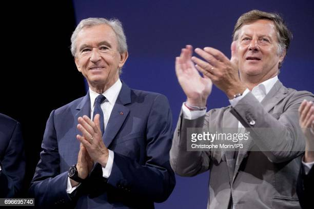 Bernard Arnault Chairman and CEO of LVMH and Sebastien Bazin Chairman and CEO of AccorHotels attend a conference during Viva Technology at Parc des...